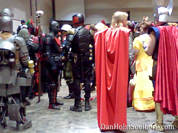Superheroes assemble! Costumed attendees await their turn to take the stage at Hamilton's Comic Con costume competition. (Please forgive my blurry photo)