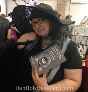 Mrs. Addams holding Shadow Abuse by Dan Holst Soelberg